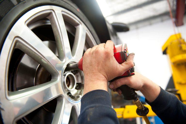 A mechanic is fixing a alloy wheel