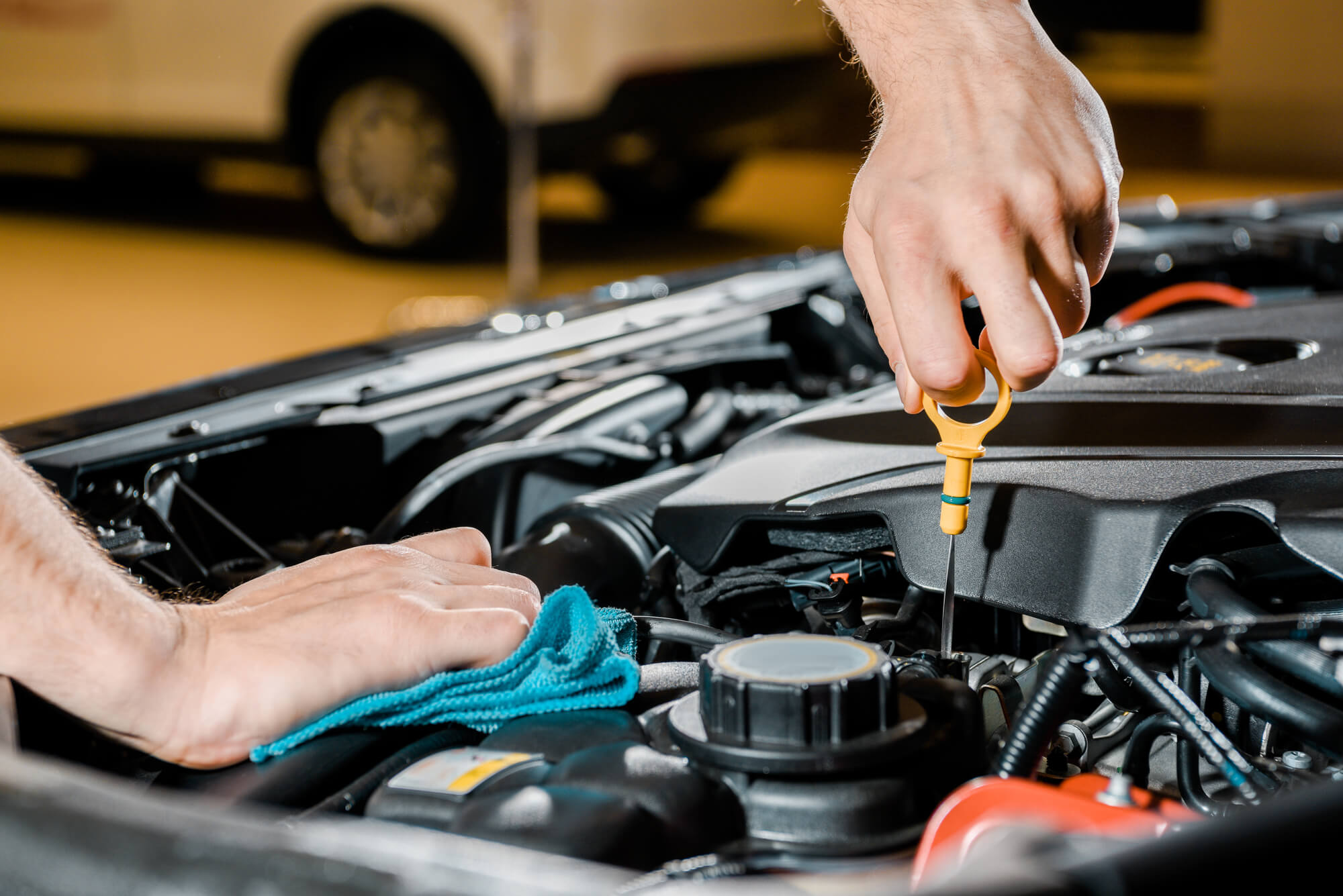 car engine oil check by a mechanic