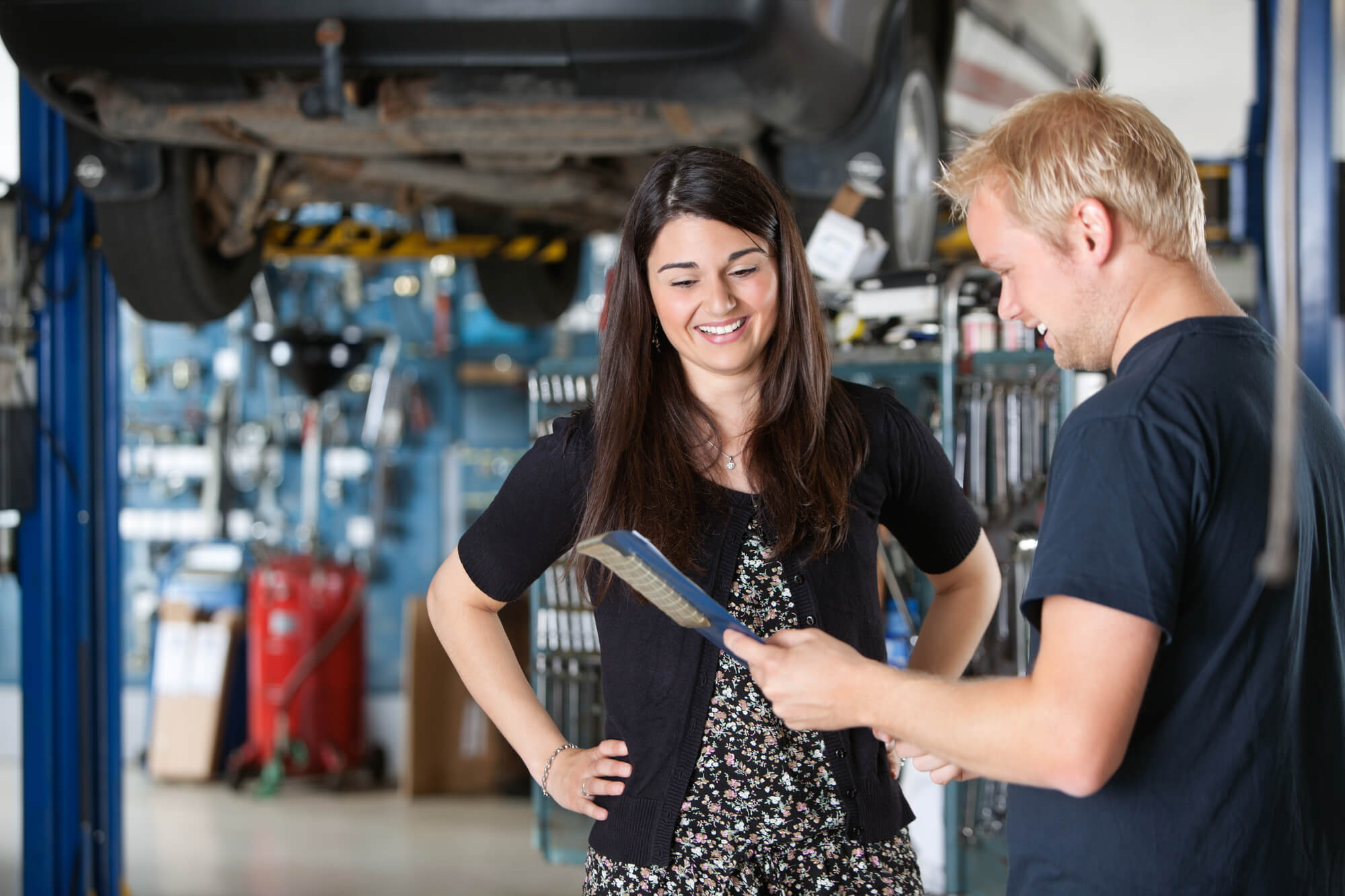 mechanic is talking to a female customer